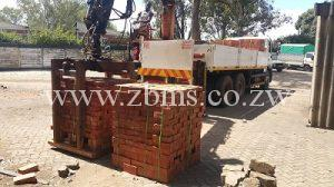 bricks for sale delivery with crane on pallets wrapped and packed
