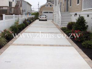 concrete driveway with brick borders